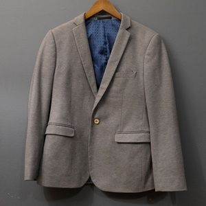 Grey blazer. Fits medium to large.